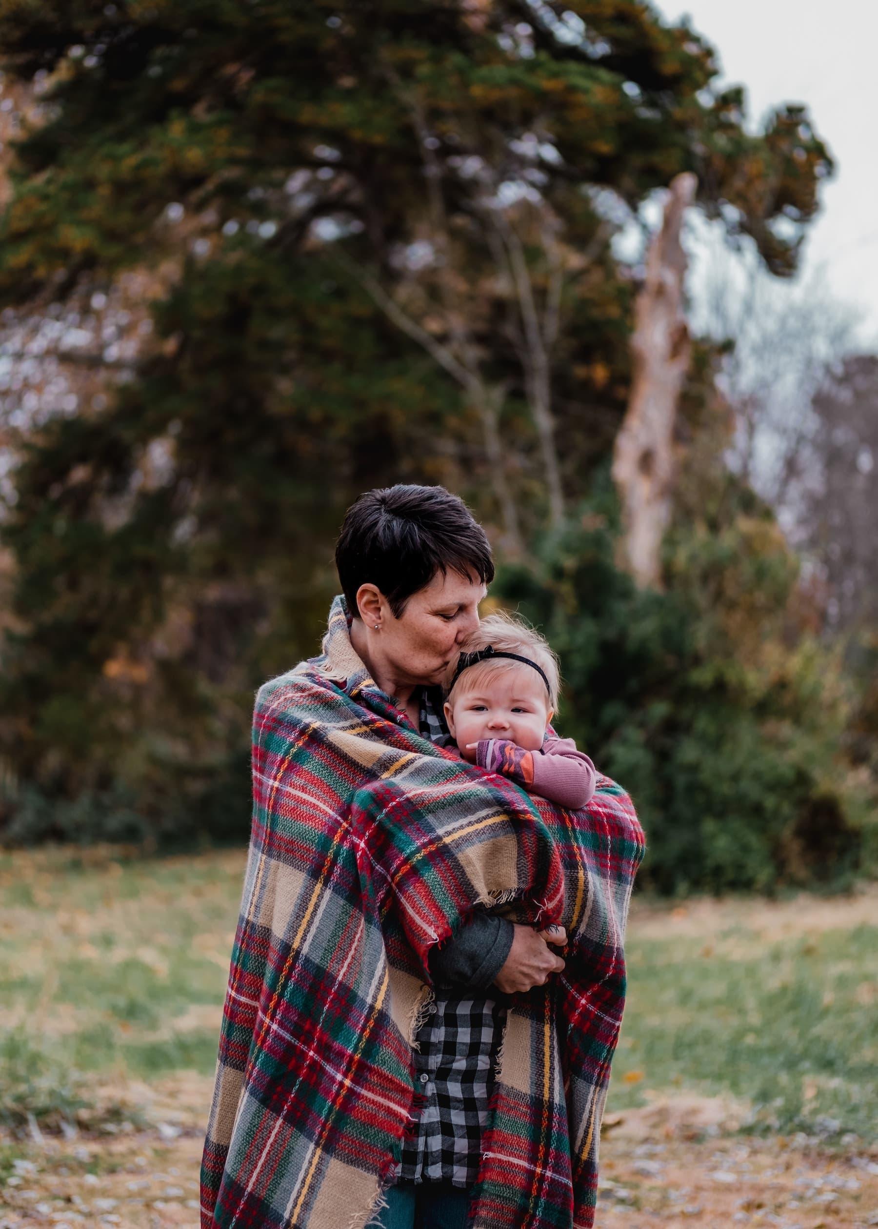 Mother hugging child, recipient of inheritance